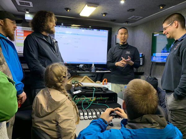 Dustin Li presents critical communications technology inside the Cisco TacOps truck.