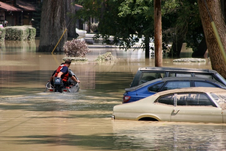 Search and rescue crews search for stranded residents