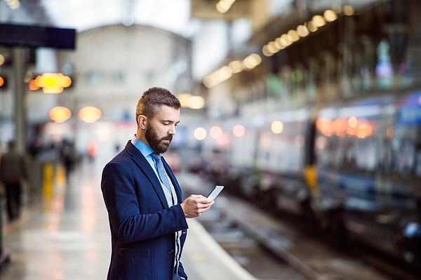 Businesswoman using voicemail to email to review her messages while commuting to work.