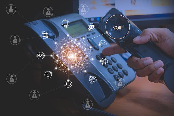 Graphic image showing how a VoIP phone can connect to the world.