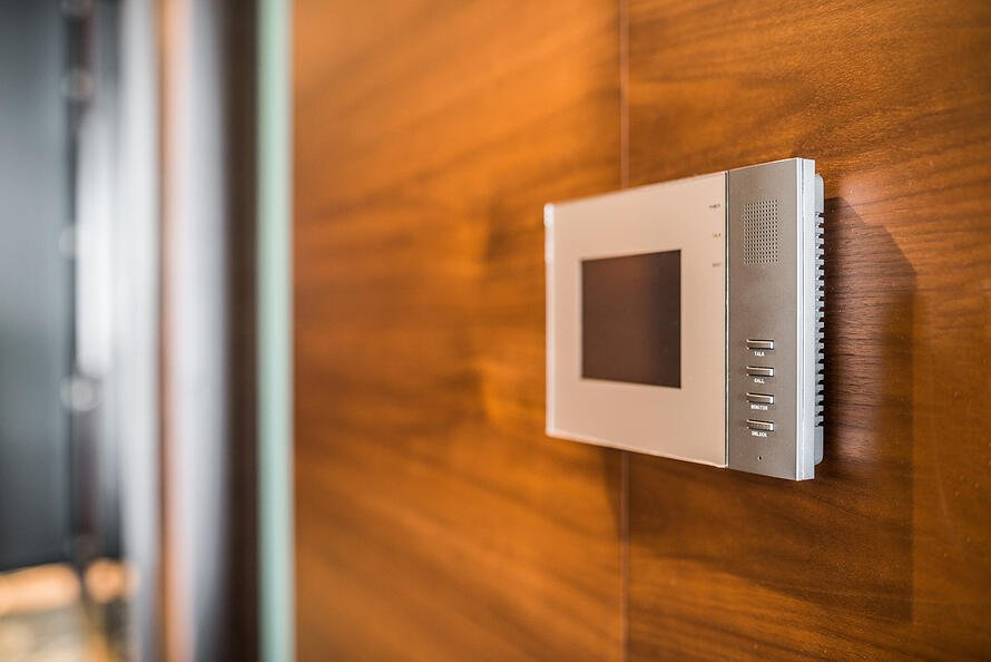 Video door system attached to a wall.