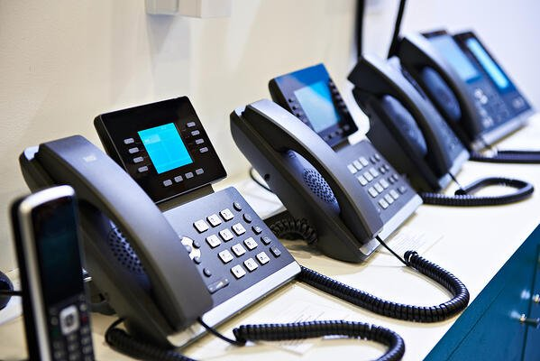 VoIP phones on a desk.