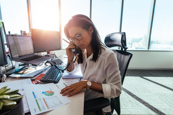 Female executive making a phone call at her desk.