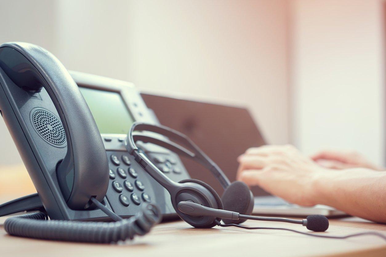 VoIP headset alongside a VoIP desk phone.
