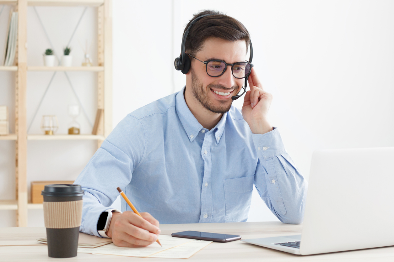 Businessman listening to a VoIP call recording in his hosted VoIP service's web portal.