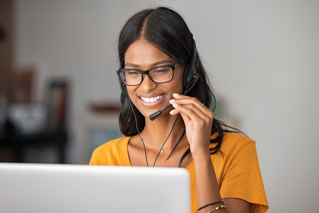 Businesswoman using a headset while on a VoIP call.