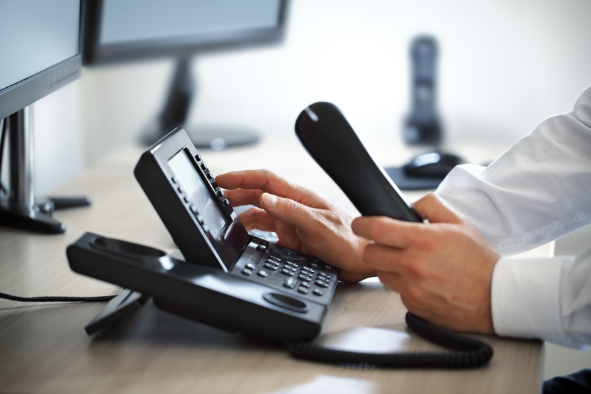Dialing VoIP Phone in an office.