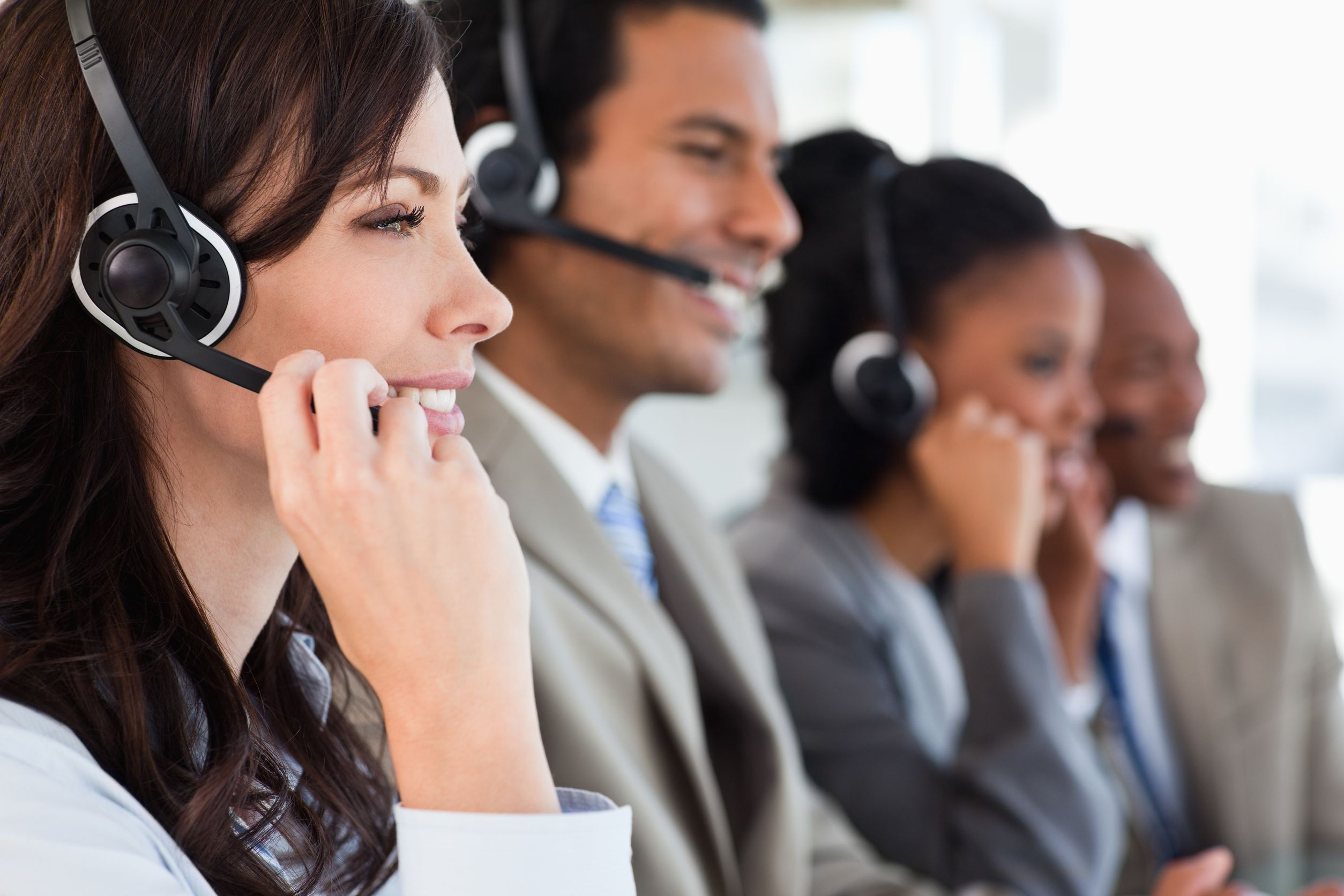 Employees taking calls in a contact center.