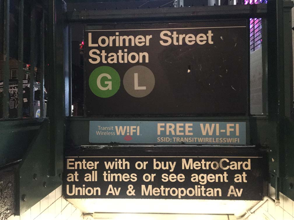 NYC subway sign promoting free WiFi.