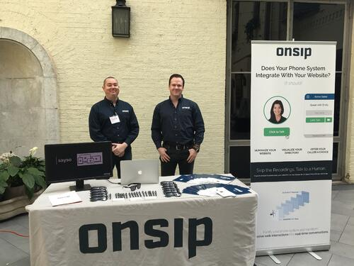 Chuck Dunne (left) and Mike Curtin (right) behind the OnSIP Technology Display booth.