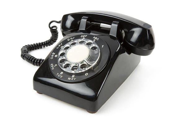 Black rotary dial phone.
