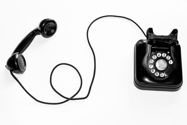 The humble telephone: handset, cord, and all.