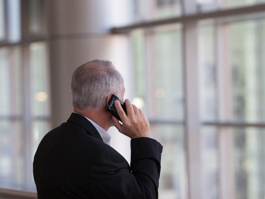 Businessman answering a work call on his smartphone.